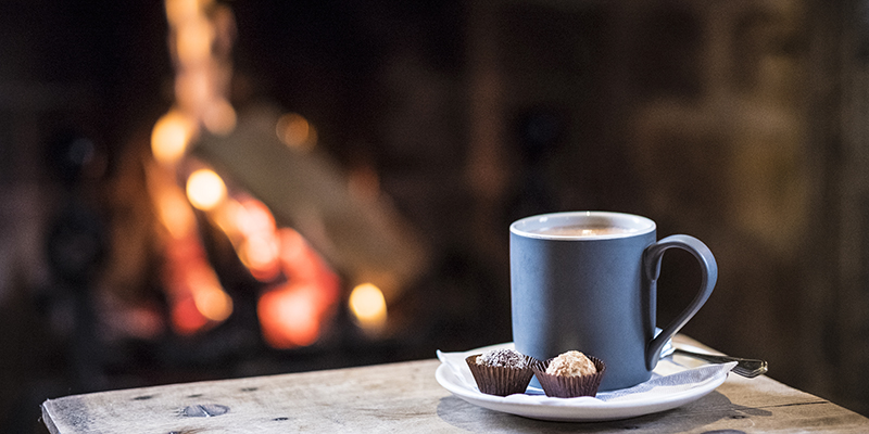 A fire and cup of hot chocolate
