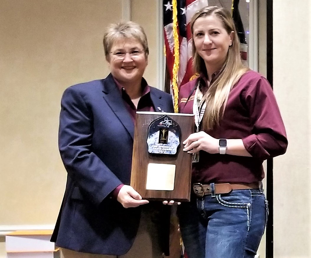 Laurie Christensen and Rachel Moreno with the Harris County Fire Marshal's Office receive the 2018 Fire Sprinkler Leadership Award