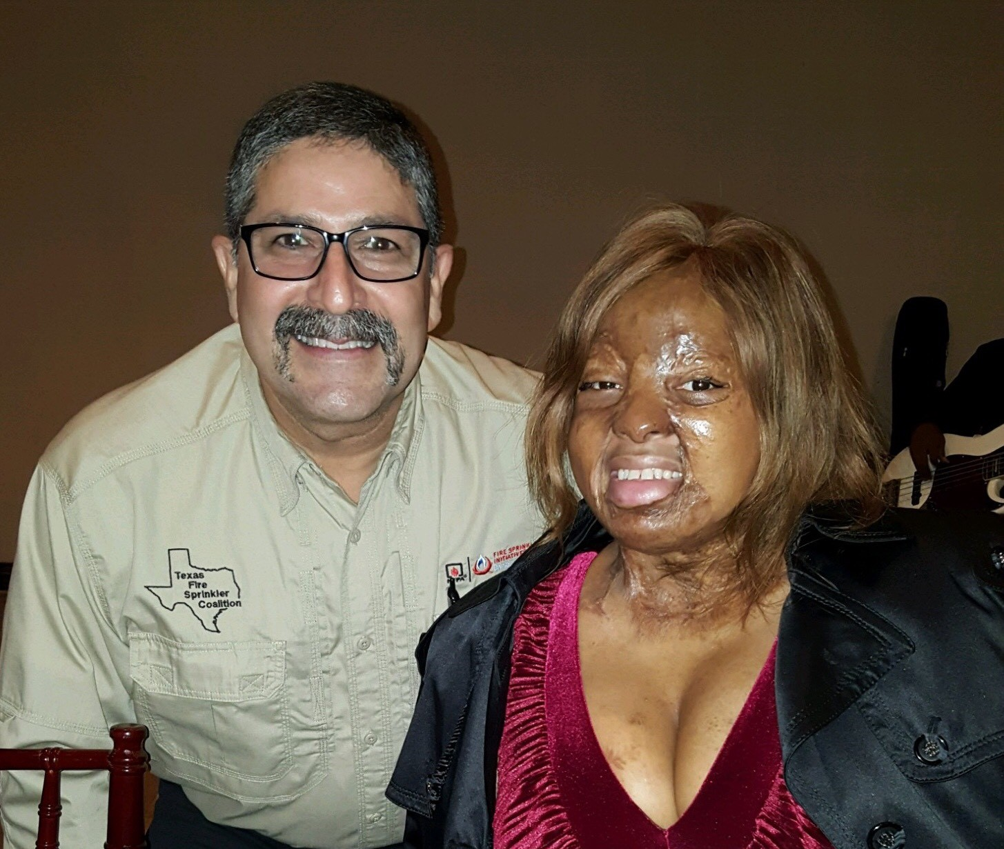 Texas Fire Sprinkler Co-Chair Roland Garcia and burn survivor Kechi Okwuchi