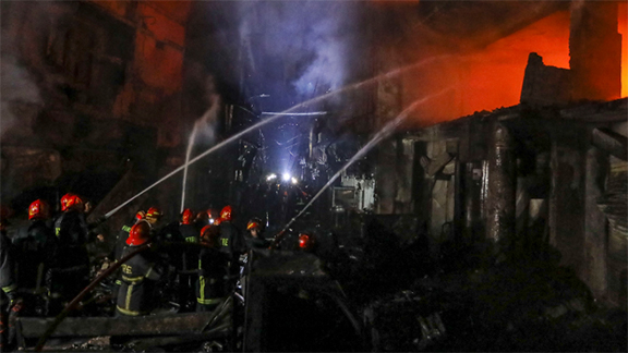 firefighters in Bangladesh battling fire