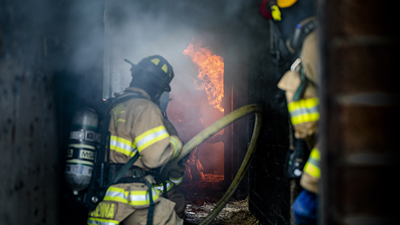 Firefighter fighting a blaze