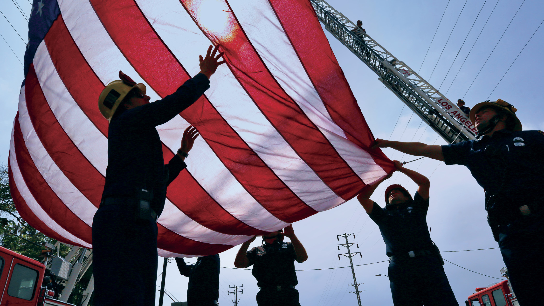 Firefighters raising a flag