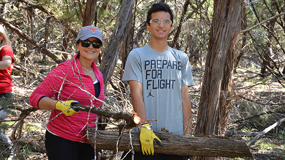 woman and teen collecting brush during Prep Day event