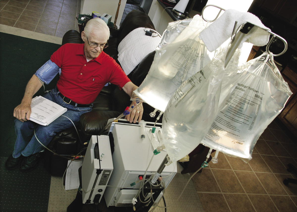 Older male on dialysis machine.