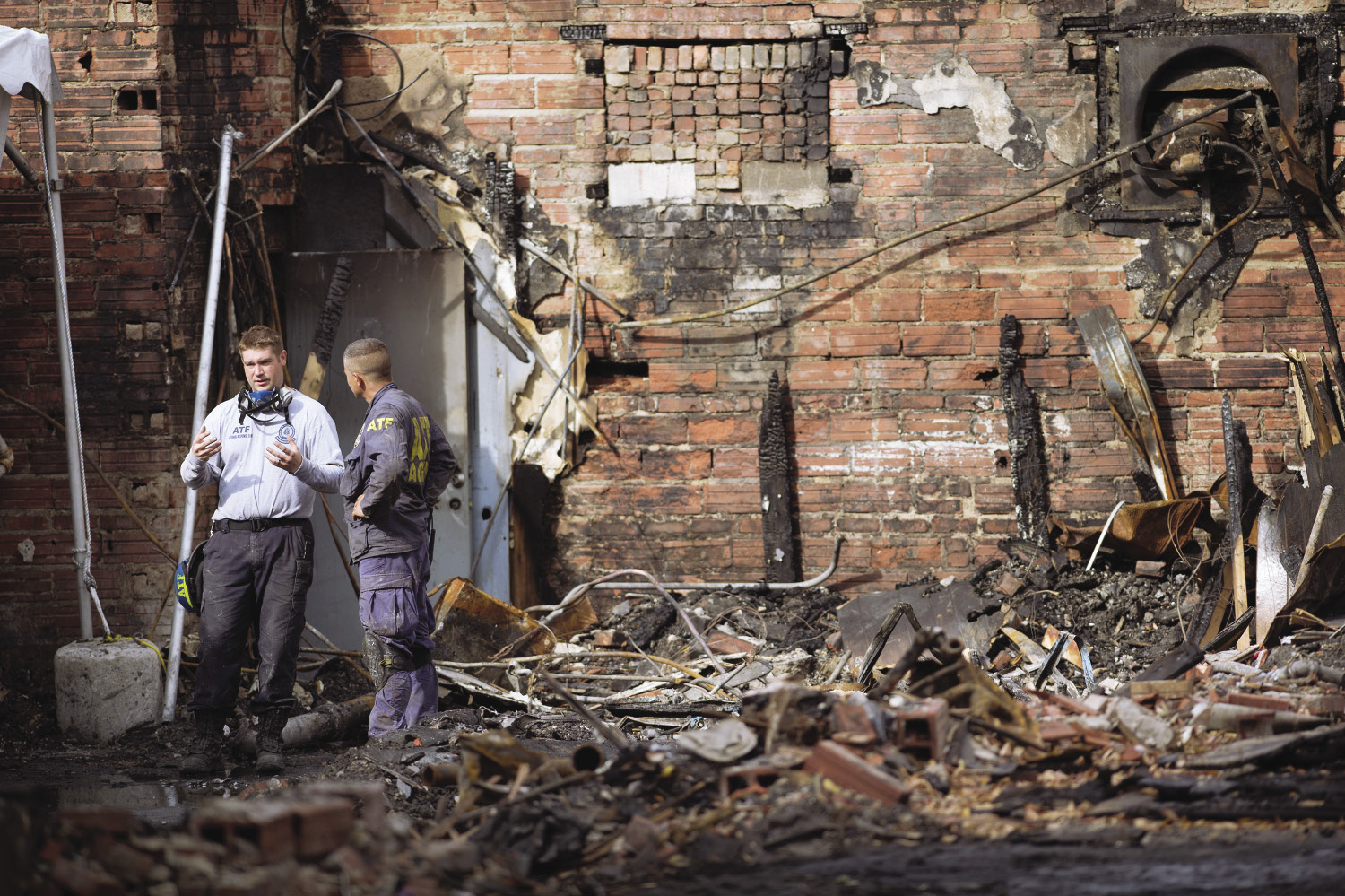 Fire investigators work at the scene of a 2015 fire that killed two firefighters in Missouri