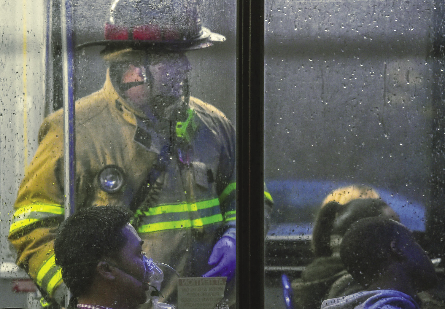 "Passengers and firefighters aboard a subway train affected by a ""smoke crisis"" in Washington D.C."