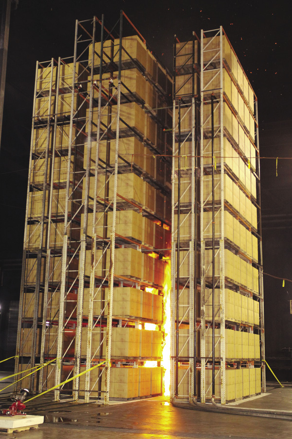 Second image of series from FM Global showing a test configuration for orifice sprinklers.  The fire has grown and is reaching up five stories.