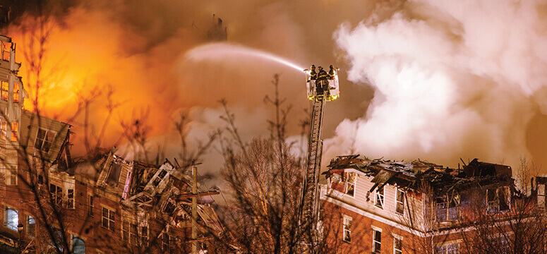 Firefighter battle a massive fire at an NFPA 13R-protected apartment complex.
