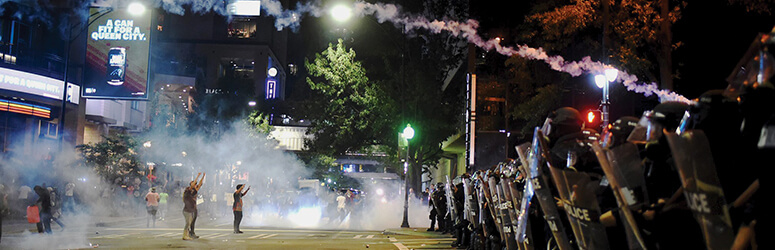Protesters meet police in Charlotte, North Carolina, in September.