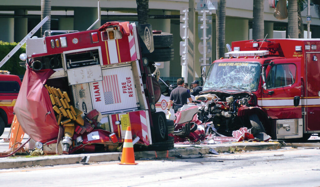 Emergency responders assist injured responders after an ambulance and a fire truck collided.