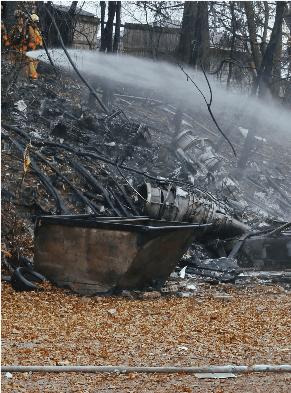 Aftermath of a business jet crash that hit a four-unit apartment building in Ohio.