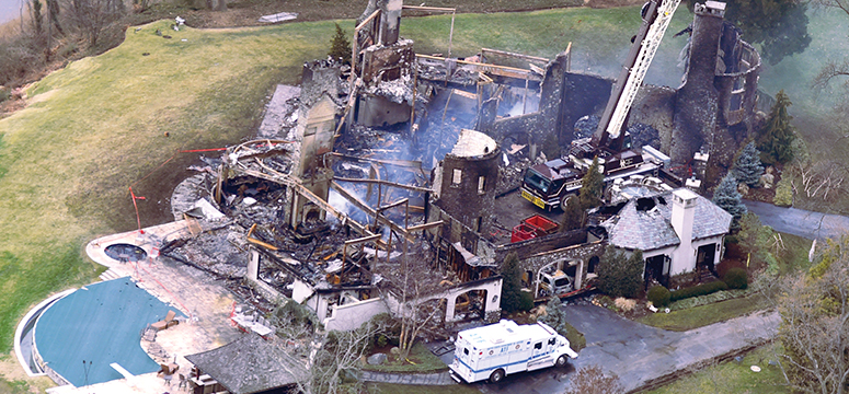 Aerial photo of a home fire that claimed six lifes including four children.  The house is in complete ruin.