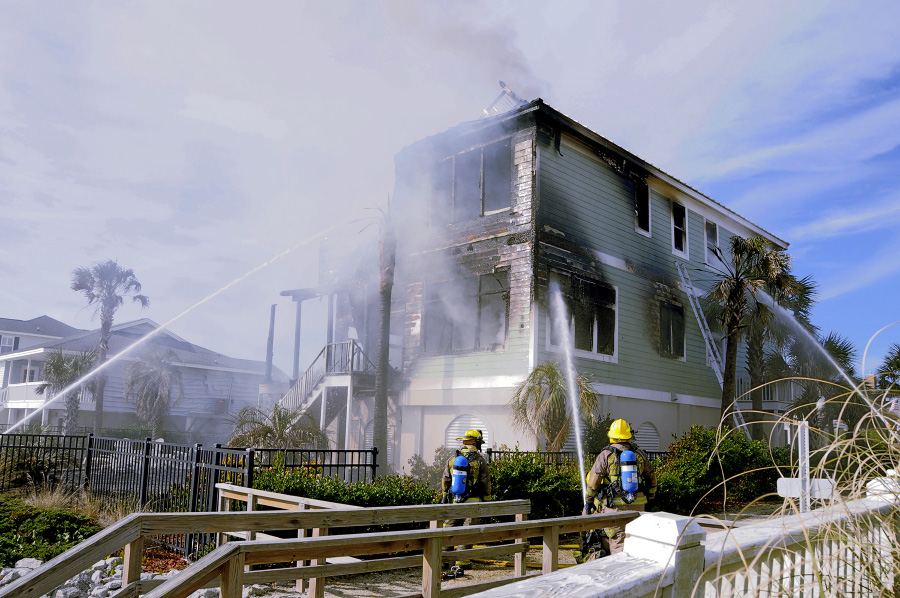 A beach house burns in South Carolina while Firefighters work to put it out