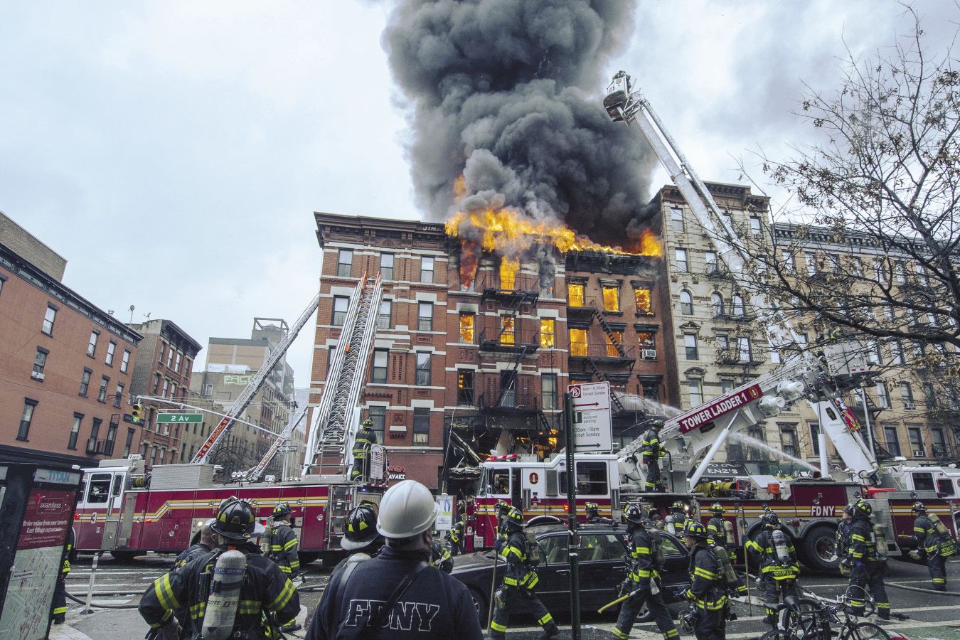 Firefighters fighting a blazing fire in an 5 story building in New York