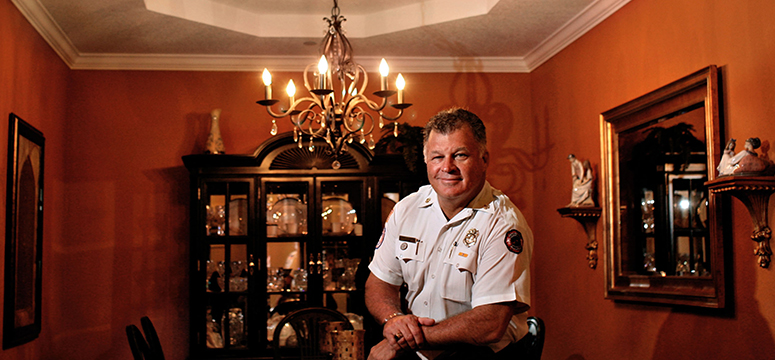Jim Large, fire chief in St. Petersburg, Florida, stands in his home which was recently sprinklered.
