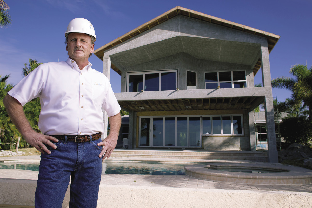 Home builder Sam Davis stands outside sprinkler home.