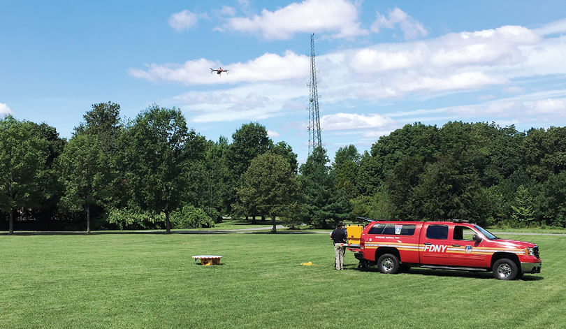 FDNY practices flying a drone that is tethered to a cord so it receives continuous power and can remain aloft indefinitely.