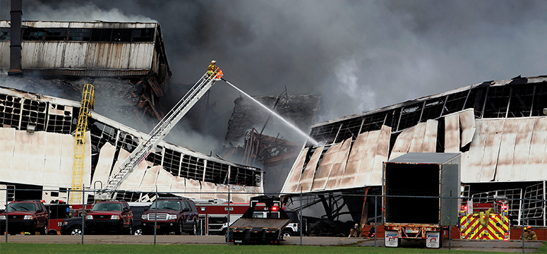 Firefighters attack the remains of the Kentucky GE warehouse that caught fire in 2015.