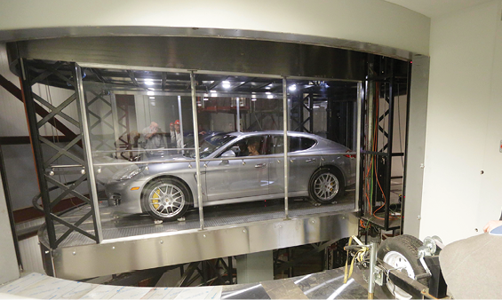 Car in car elevator designed to transport residents'vehicles to their high-rise homes.