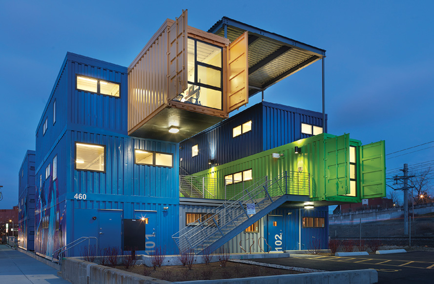 Building made from shipping containers.  Shipping containers are used in a variety of applications, including residences, emergency housing, and office buildings.