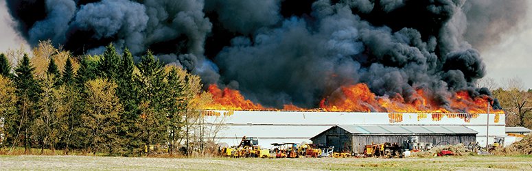 Fire rages in an electrical storage and repair facility in Maine.