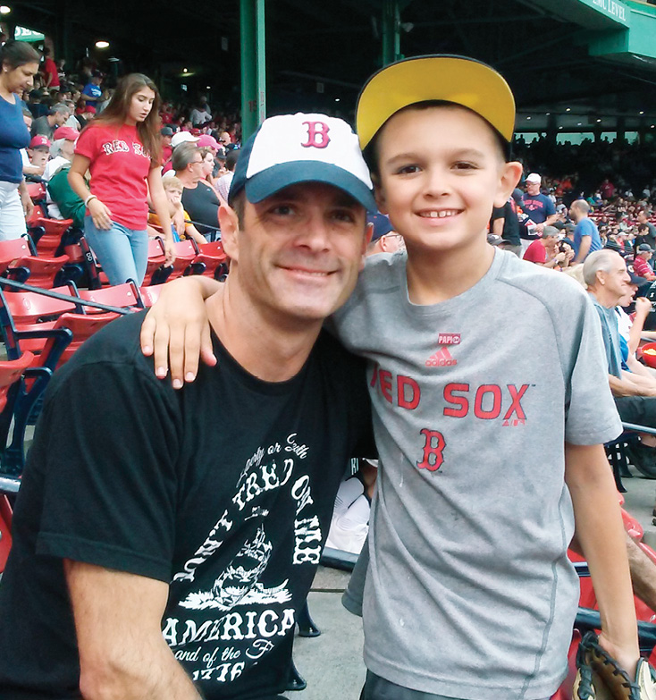 Glenn Preston with son Jake at a Red Sox game.