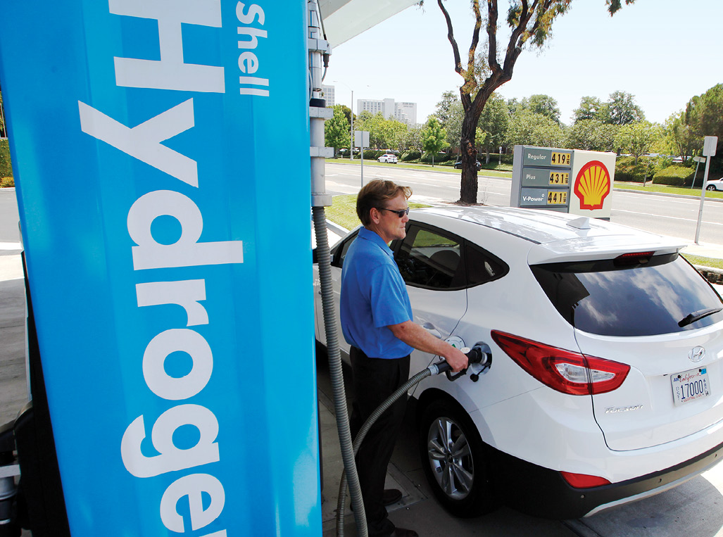Man fuels up his car at  a Shell Hydrogen station