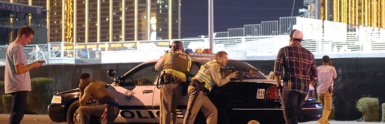 Las Vegas police take cover during active shooter incident