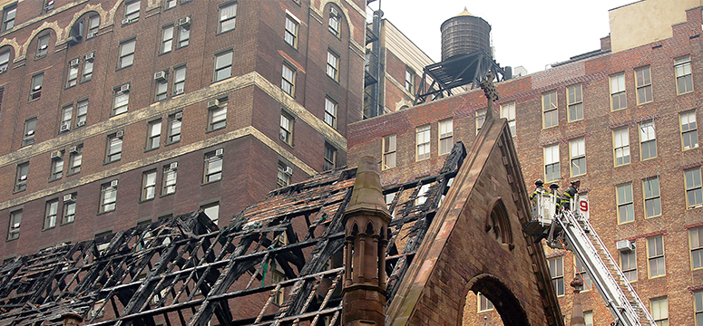 Firefighters work at the scene of a church fire in New York