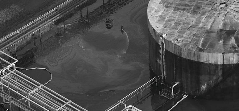 Aerial shot of an oil worker at a refinery storage facility near Houston following Hurricane Harvey