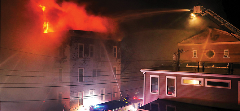 Firefighters attack a 10-alarm fire