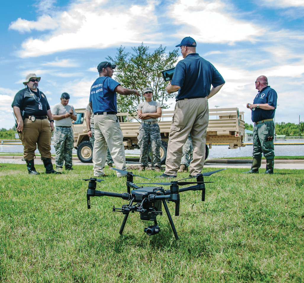 Members of the Public Safety UAS Response Team of North Texas brief the National Guard on the DJI M210 drone in the foreground used to fly recovery missions in Harvey's Aftermath