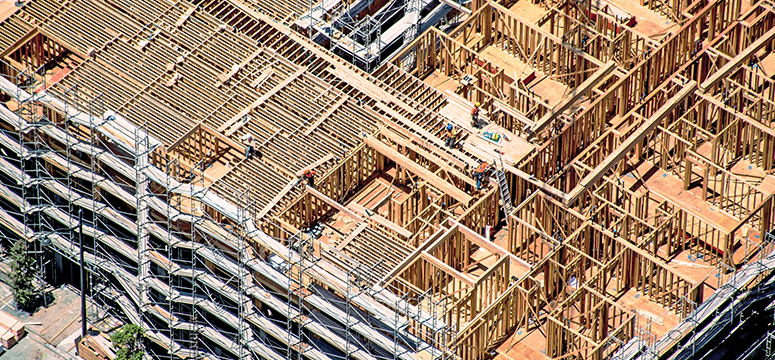 A wooden framed building currently under construction.