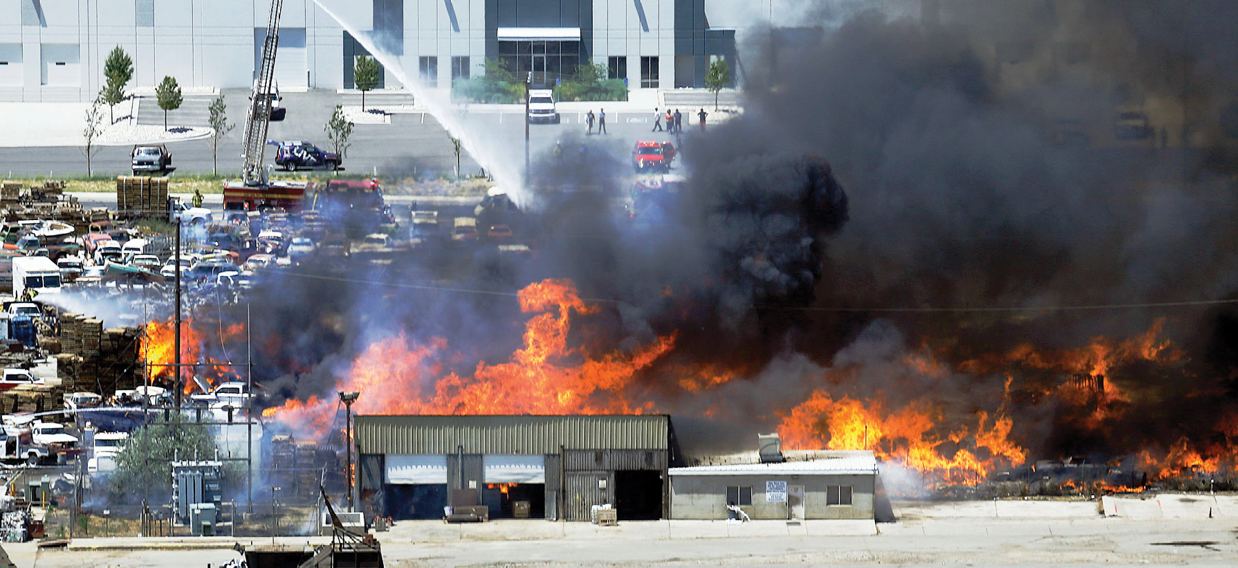 Firefighters battle a blaze at a commercial storage yard in Utah.