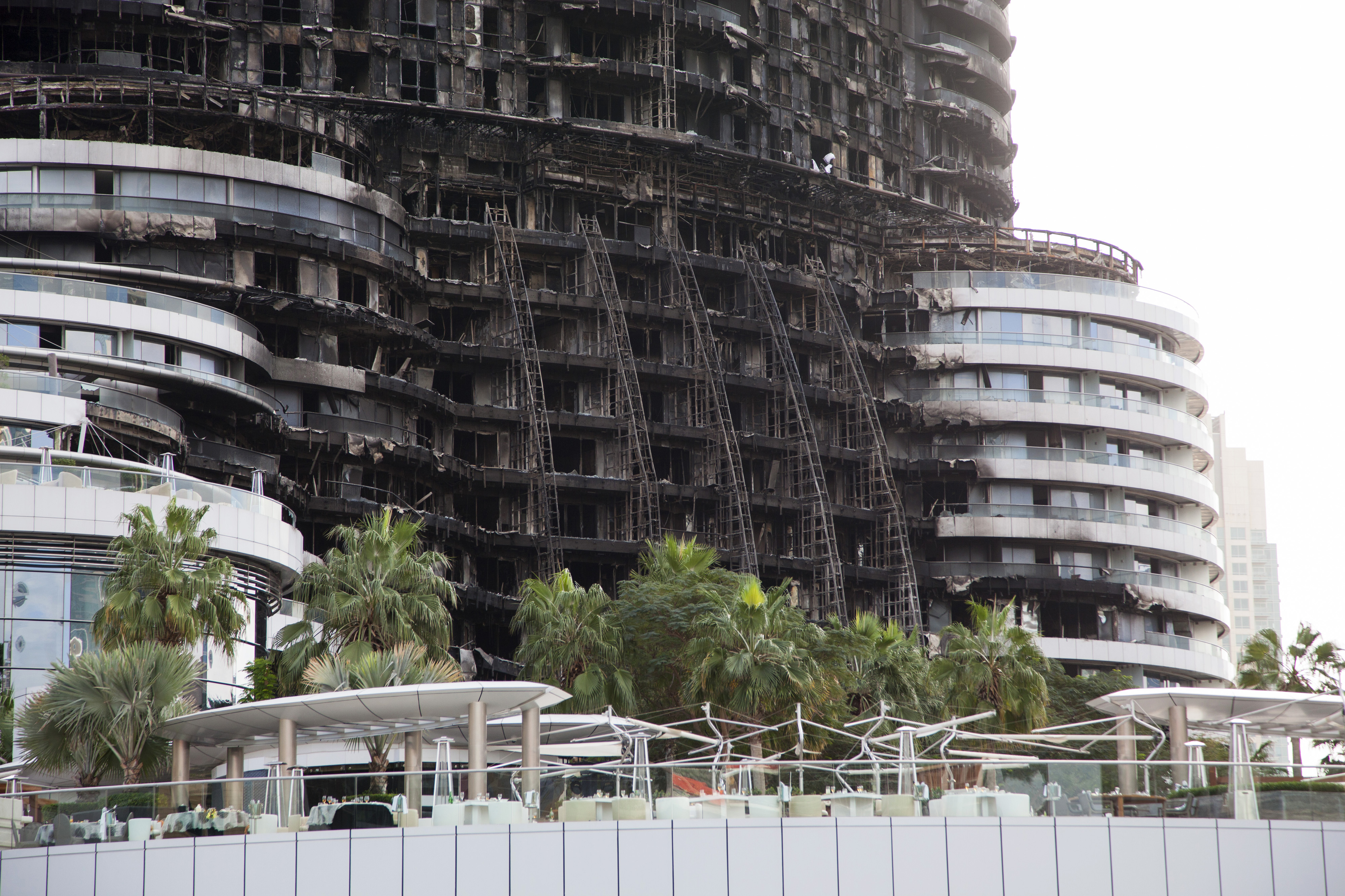 Fire damaged apartments sit on the upper floors of the Address Downtown Dubai hotel