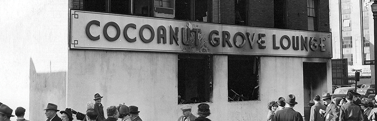 On-lookers examine the aftermath of the Cocoanut Grove fire