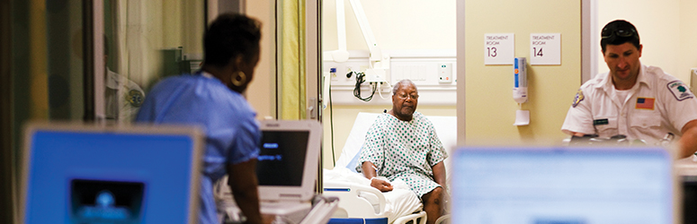 Man sits up in a hospital bed
