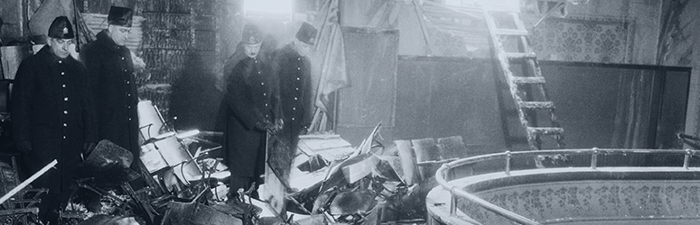 Fire investigators look at the remains of the Laurier Palace Theatre