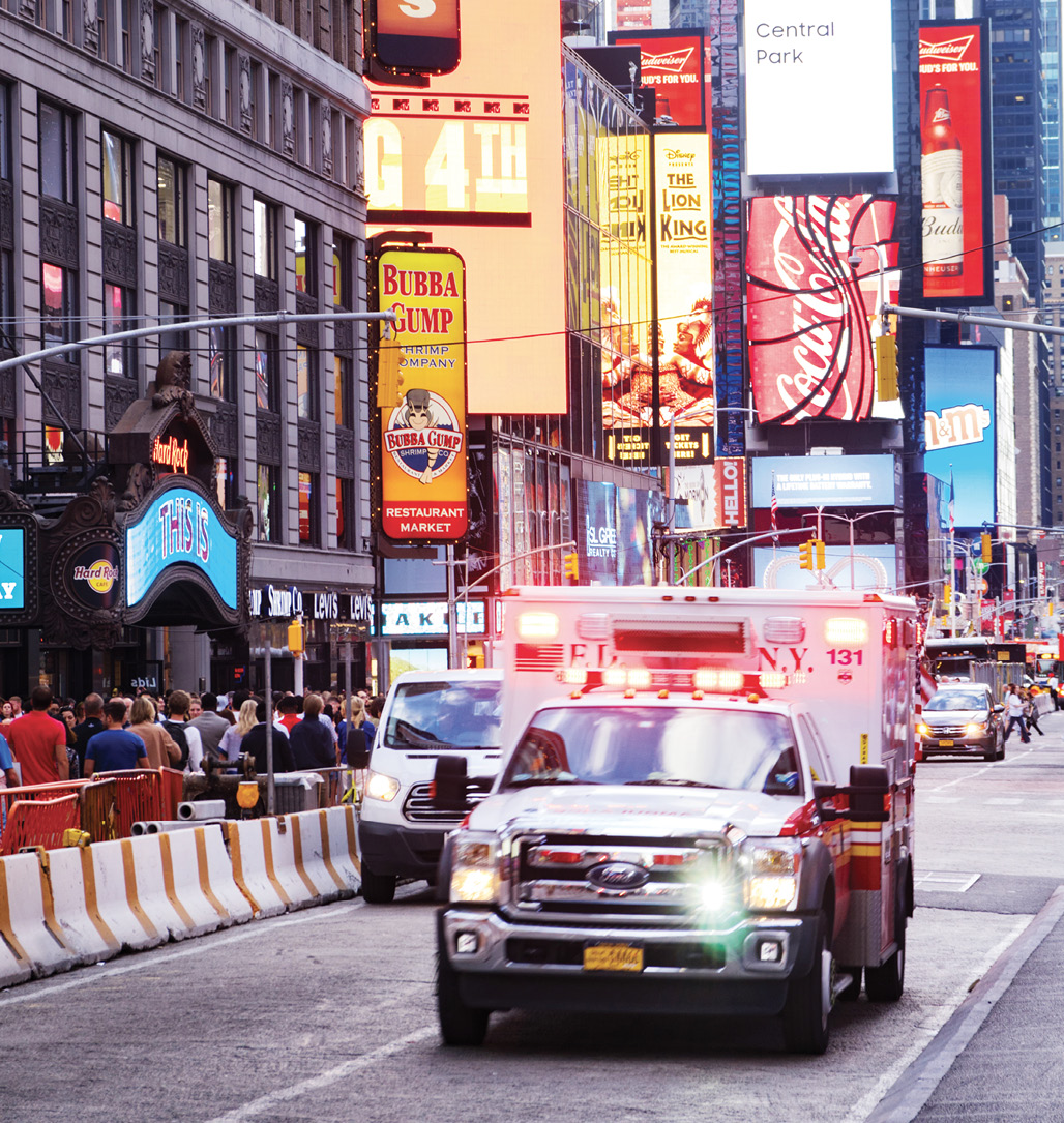 Ambulance drives through Time Square in New York City