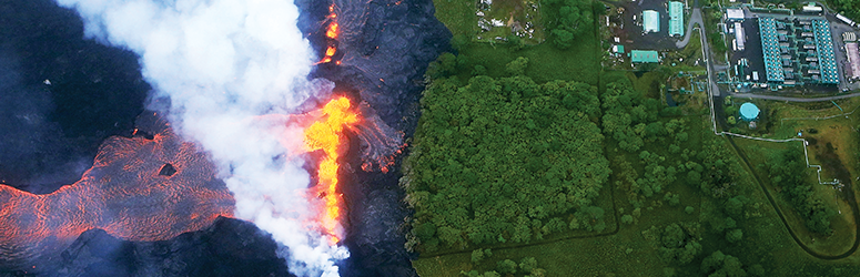 Aerial photo of lava flowing towards a facility