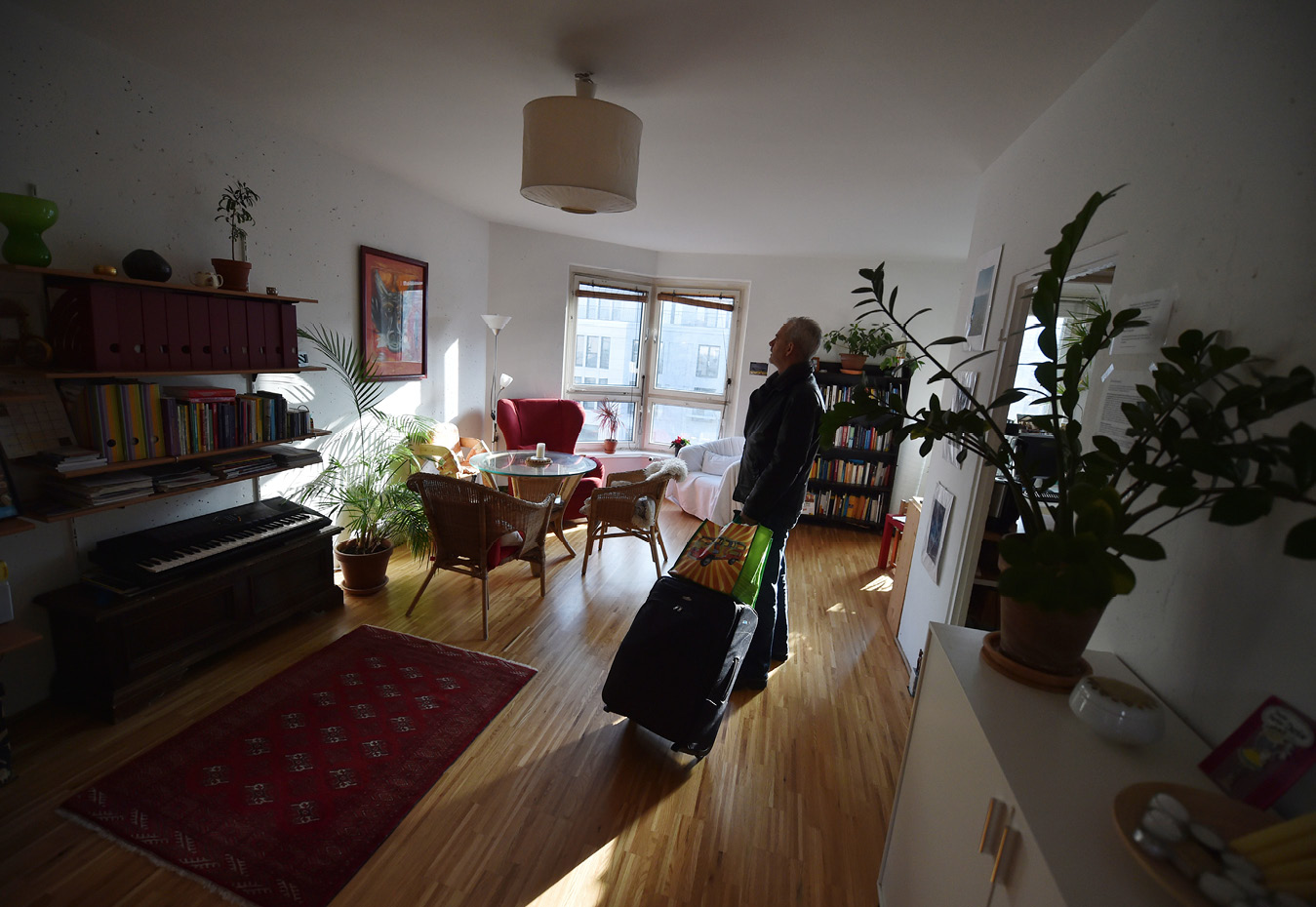 Man standing in a living room of an airBnB.