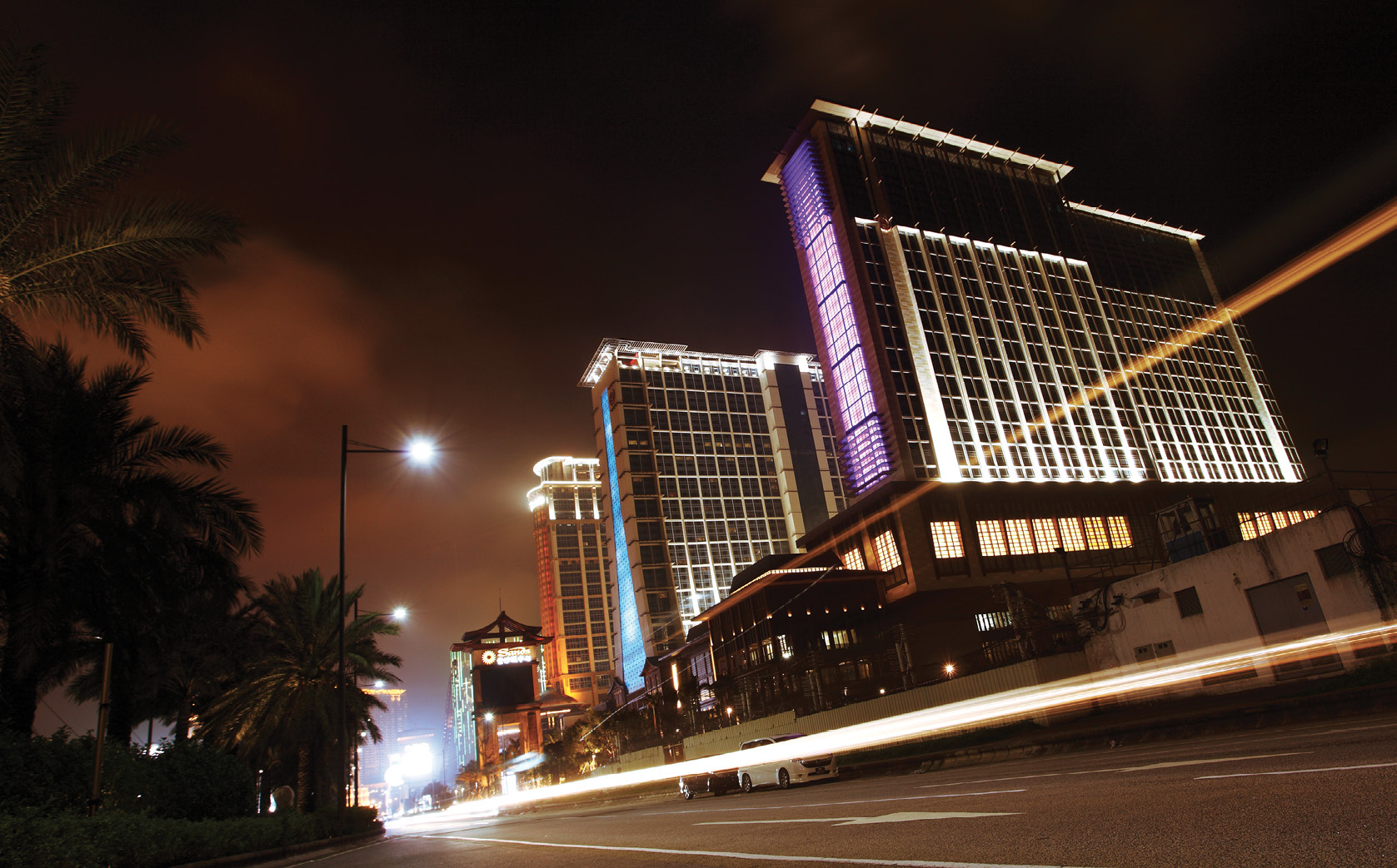 Macau's Cotai strip at night with an array of resort/casinos