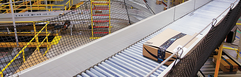 Amazon package moving down a conveyor belt