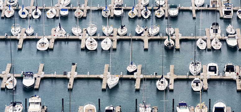 Aerial shot of a marina with dozens of boats connected to power stations