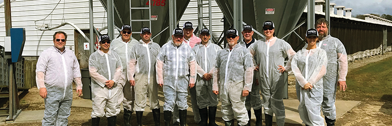 Group shot of the NFPA 150 technical committee outside of a farm