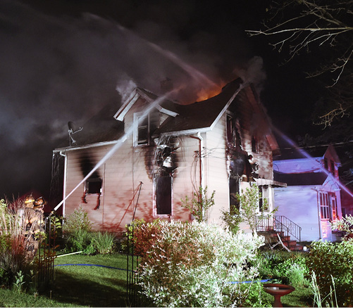 Firefighters at the scene of a house fire in Michigan.