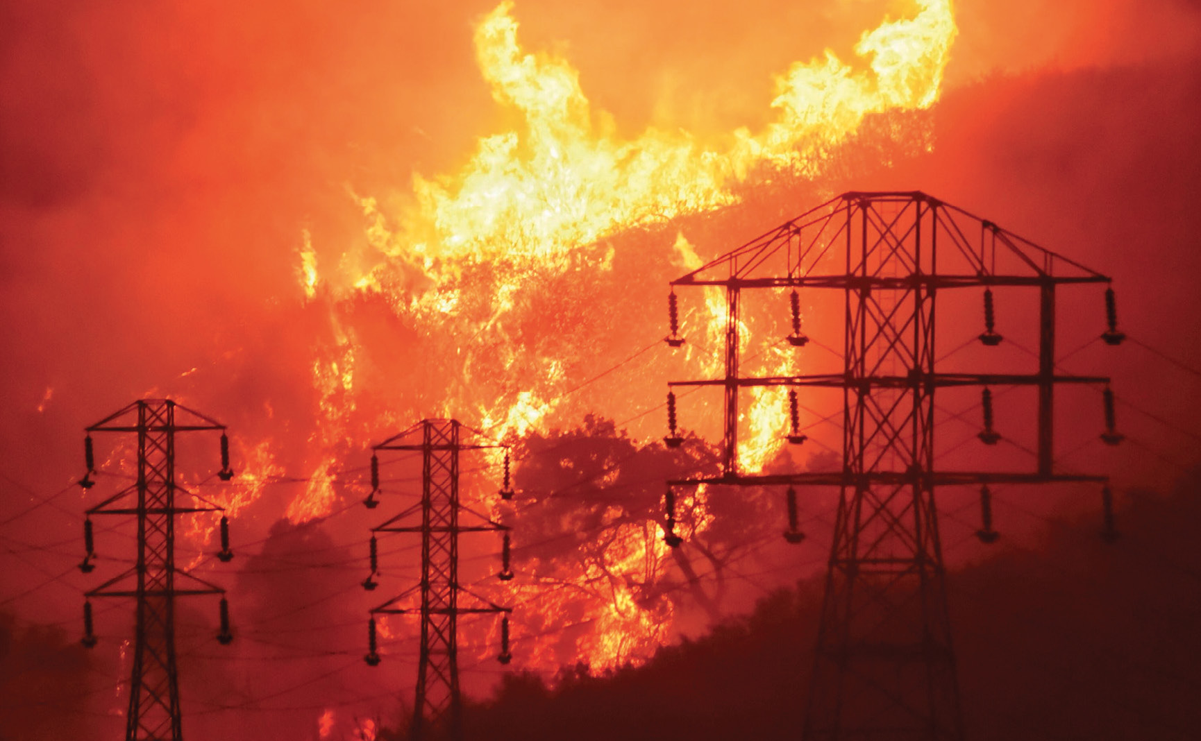 Wildfire burns near power lines in California