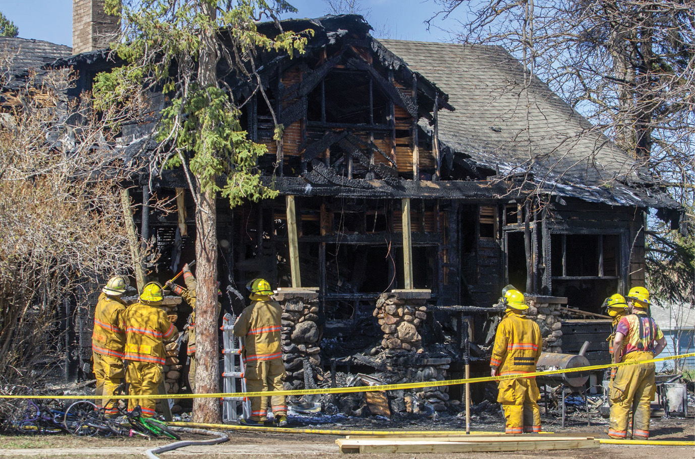 Firefighters work on the remains of a house fire in South Dakota that claimed the lives of five children