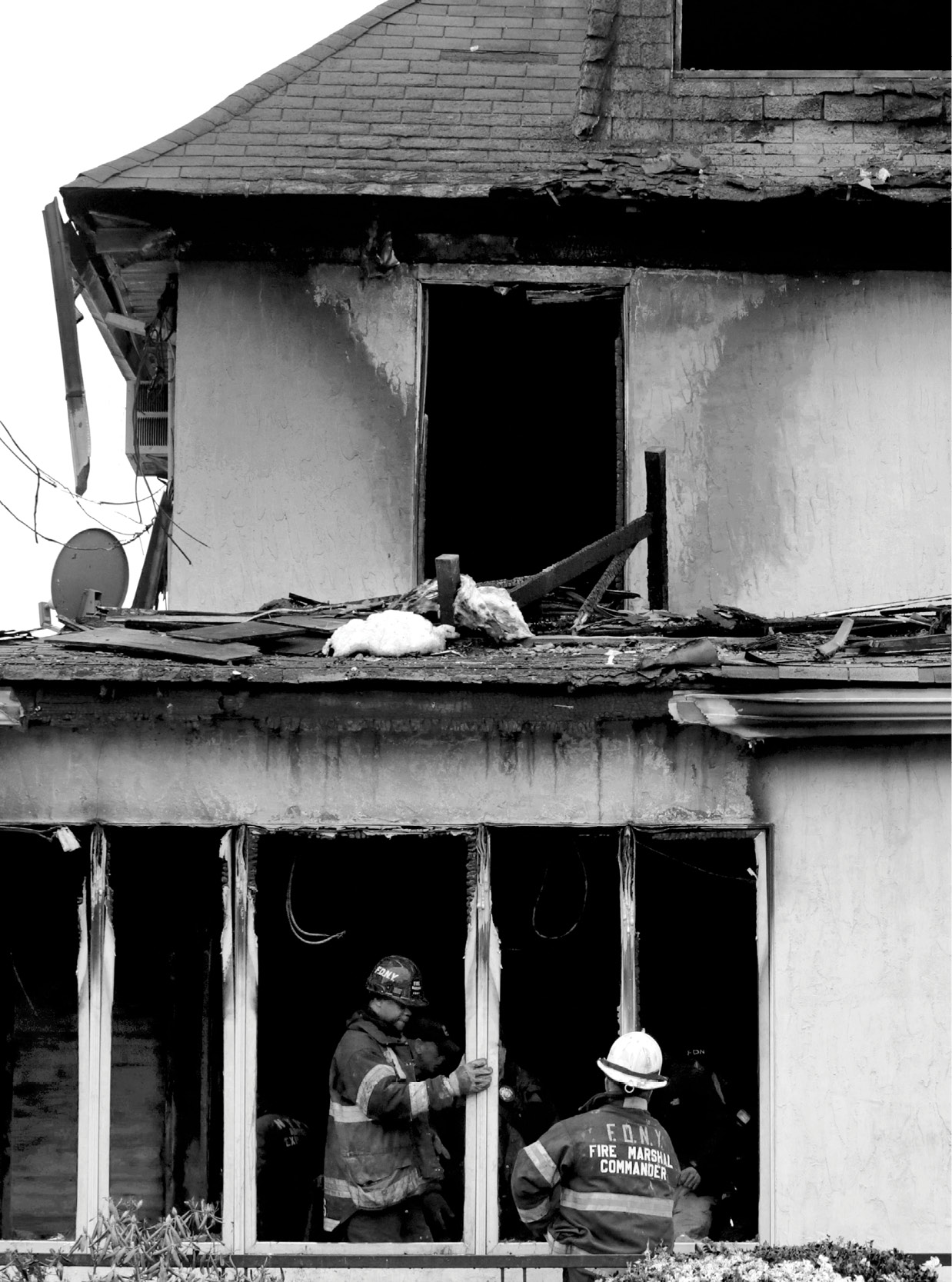 Firefighters inspect the scene of a fatal fire in New York.