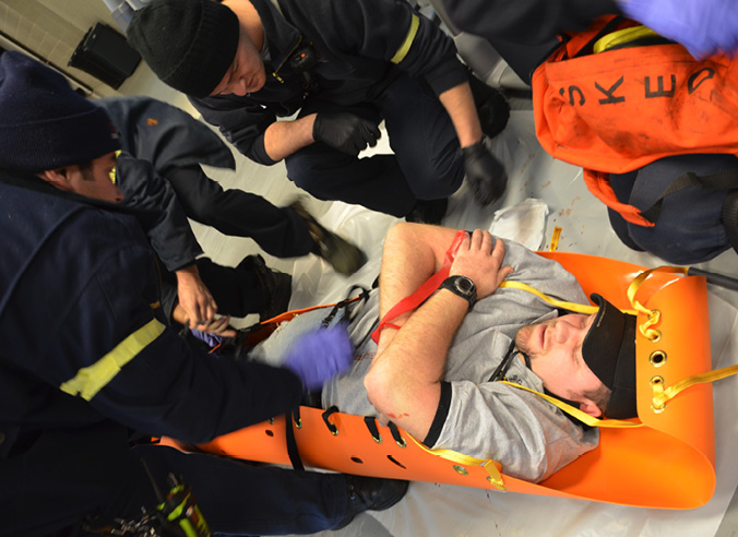 Maryland University student is attended to in a stretcher by emergency personnel during an active shooter training exercise.